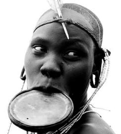 """Mursi Lip Plate Ethiopia"" by Eric Lafforgue on Flickr"